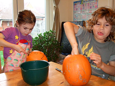 scooping out pumpkin brains